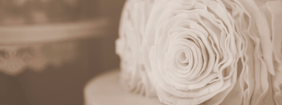 three tier wedding cake with ruffle rose