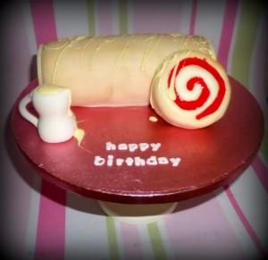 Swiss roll and custard birthday cake